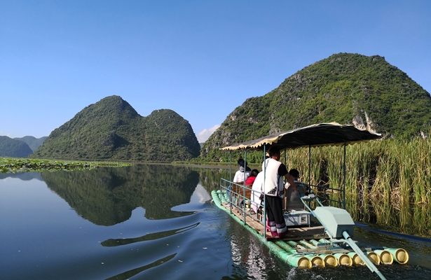In pics: Tourists enchanted by lotus, landscapes at Puzhehei