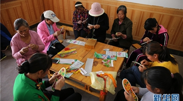 Yunnan village girl opens embroidery plants to battle poverty