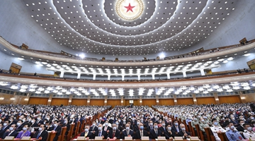 Third session of 13th NPC holds closing meeting