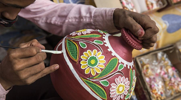 Indian potters make earthen lamps for upcoming Diwali in New Delhi
